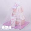 torta 3 pisos con ajuar rosado y tul
